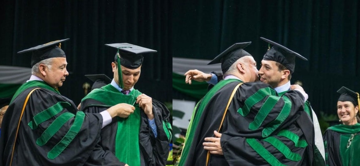 dad and son hugging and graduating