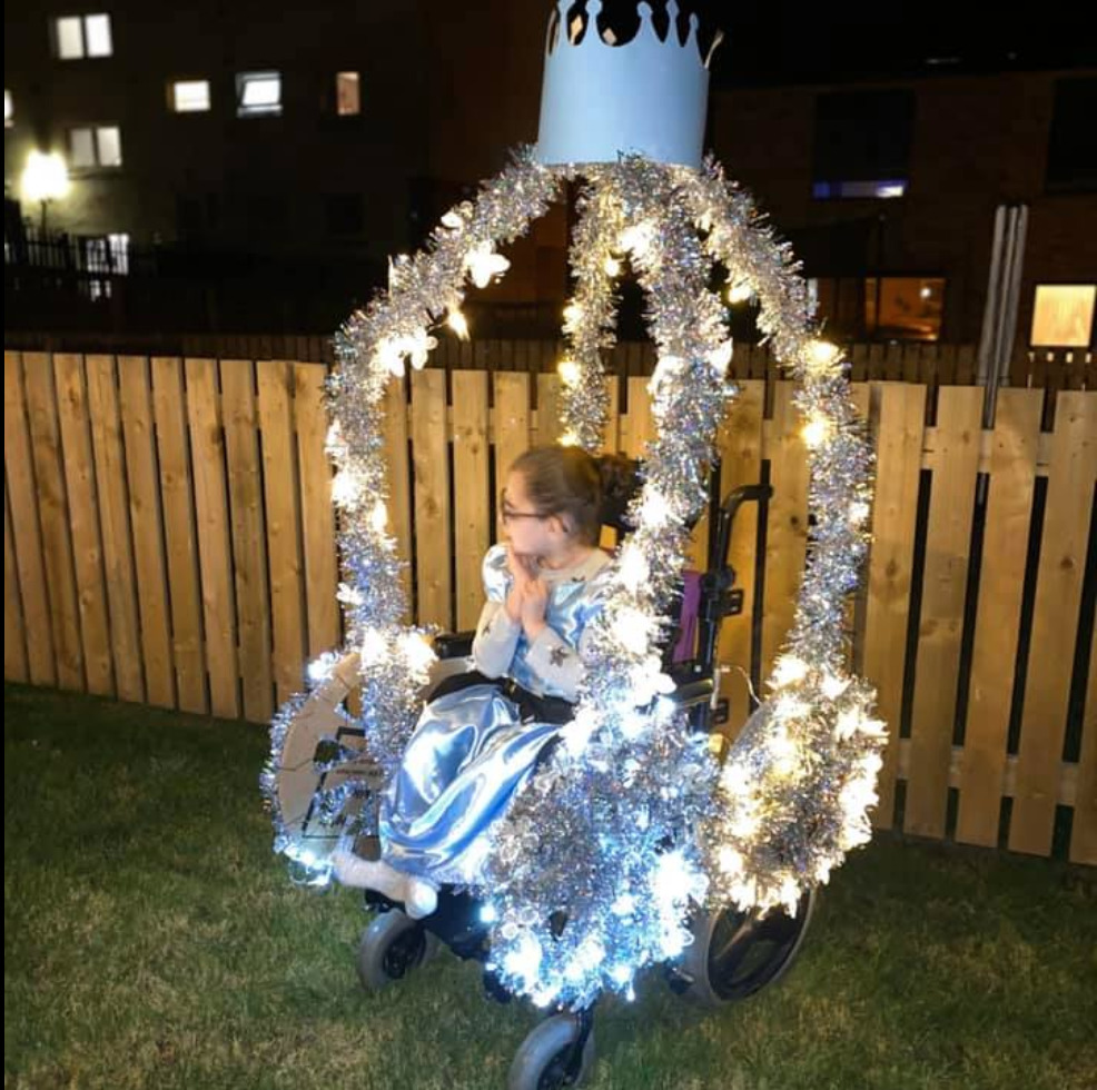 Ava in her wheelchair carriage on Halloween