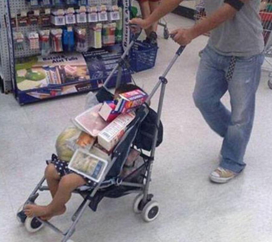guy pushing buggy with baby