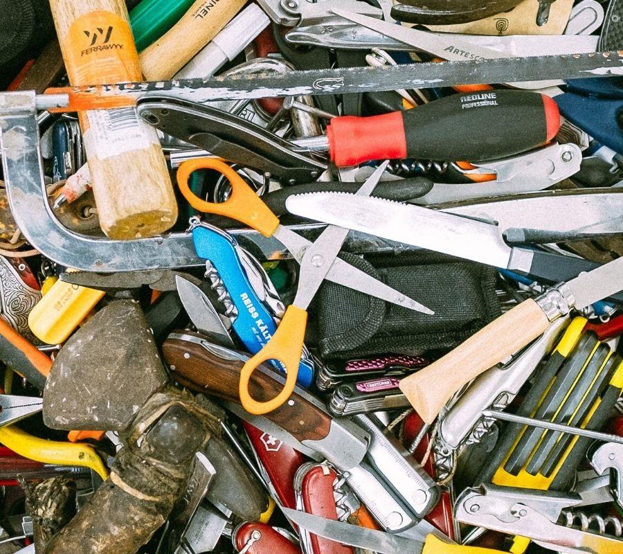 scissors in a pile of tools