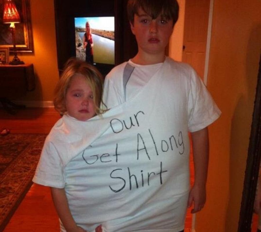 two kids in one shirt that says 'our get along shirt'