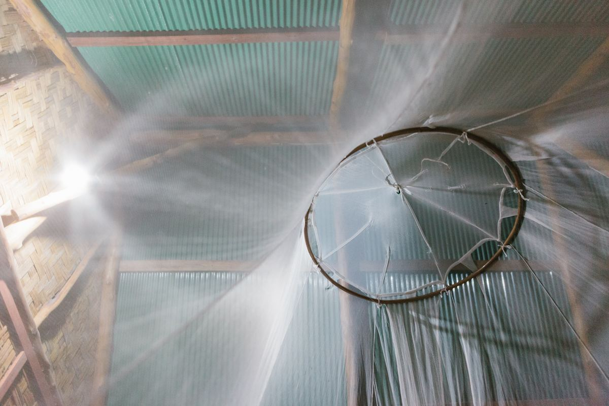 mosquito netting hung over bed