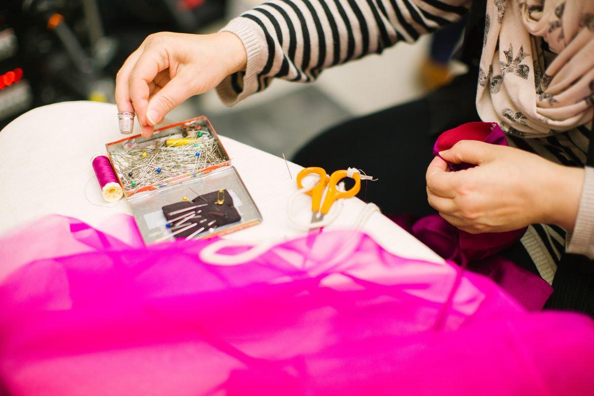 seamstress sewing a garment