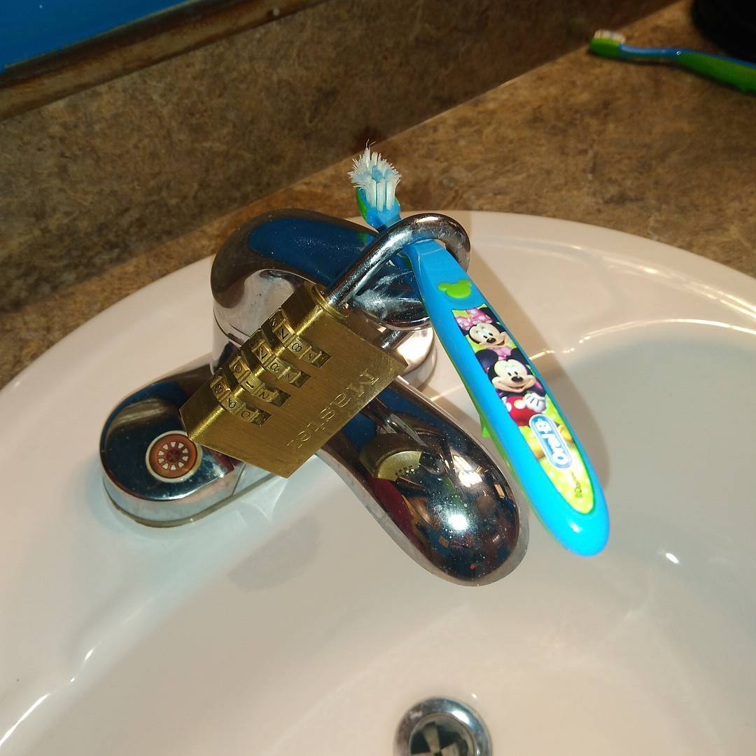 a toothbrush locked to the sink
