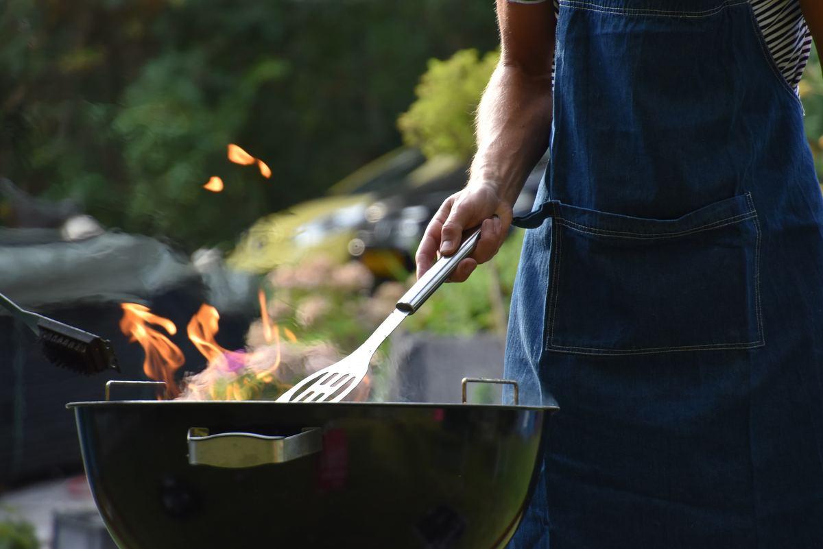 dude BBQing at grill