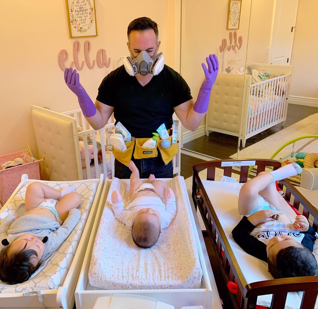 dad preparing to change three diapers