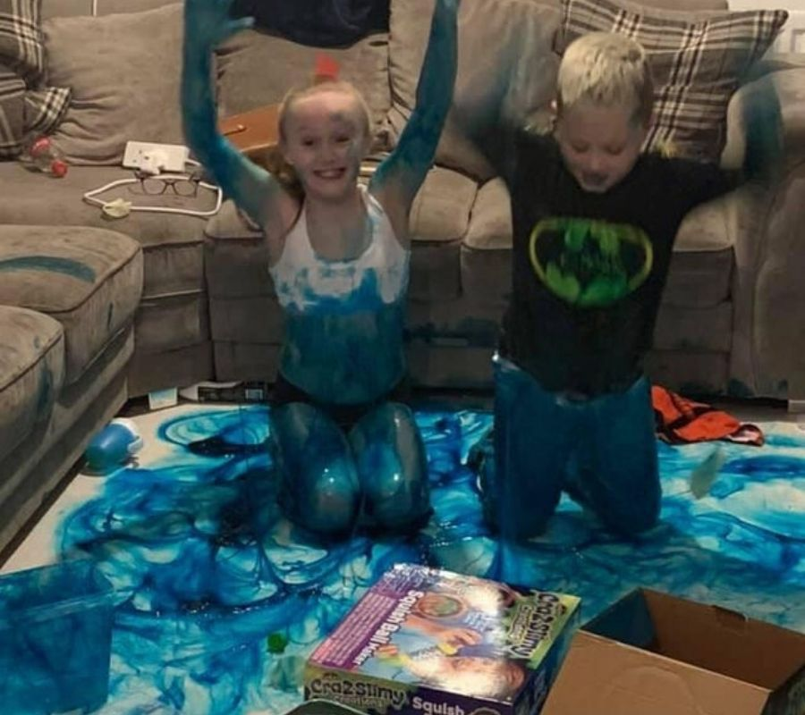 kids playing with blue paint