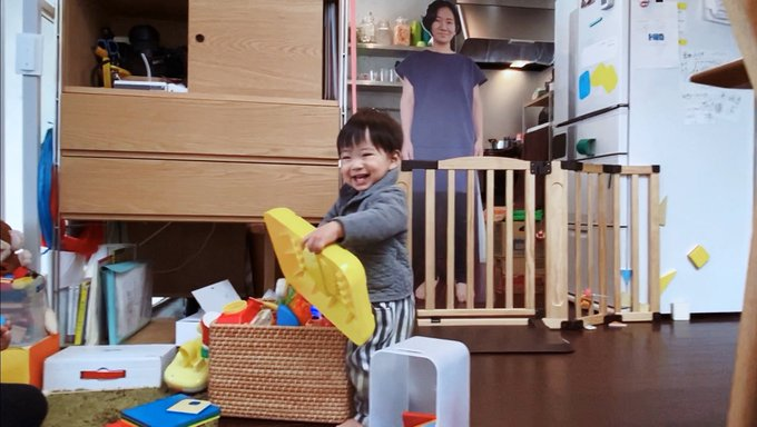 child plays happily while the cutout is in the background