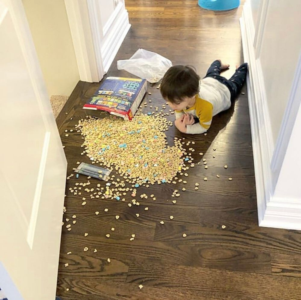 Kid steals and spills whole box of lucky charms on the ground