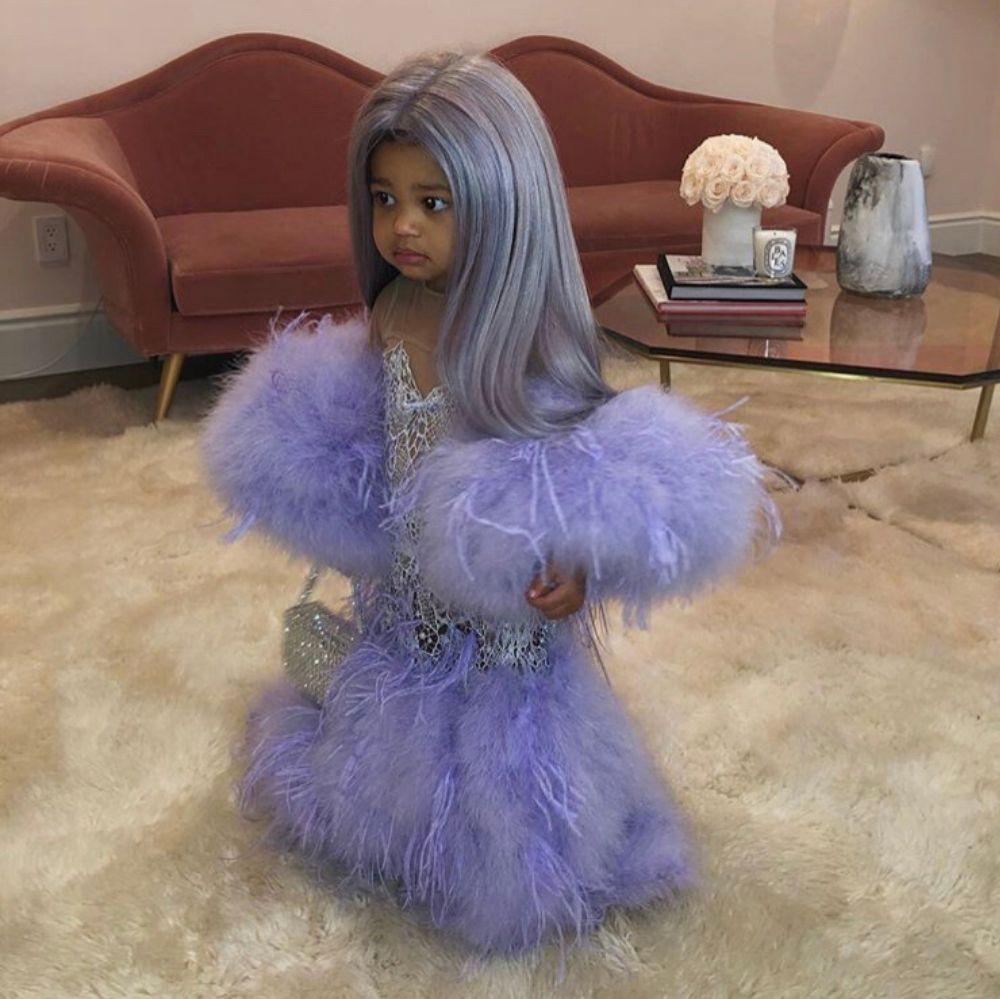 stormi wearing an imitation of Kylie's met gala dress