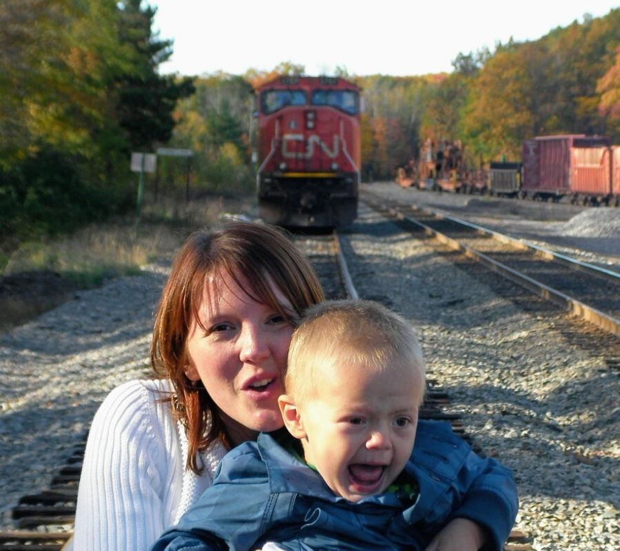 taking a picture in front of a parked train