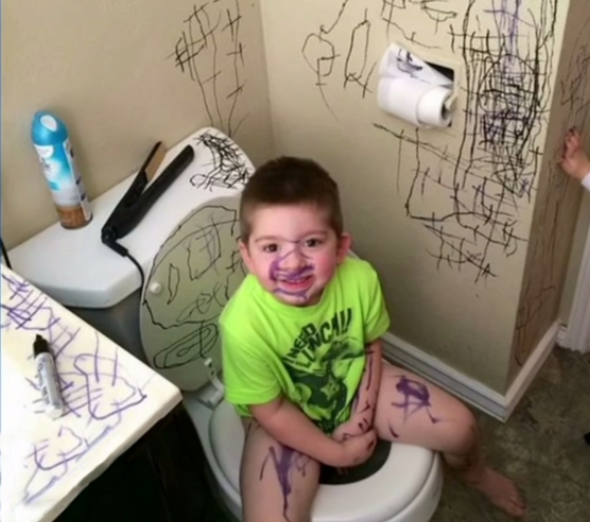 kid sitting on the toilet