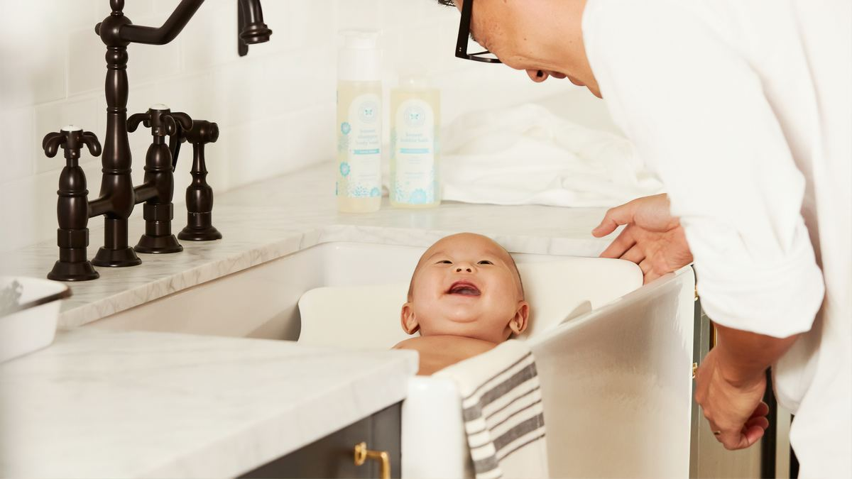 baby in sink with father