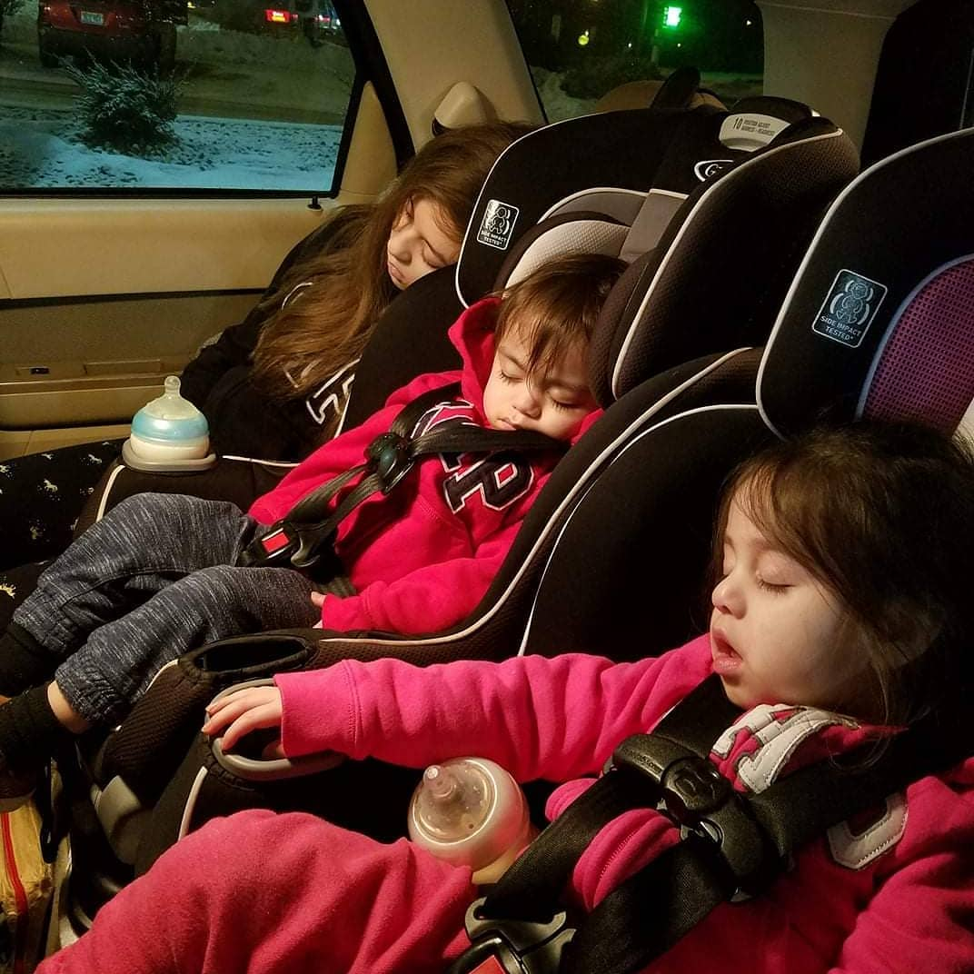 three kids passed out in their car seats