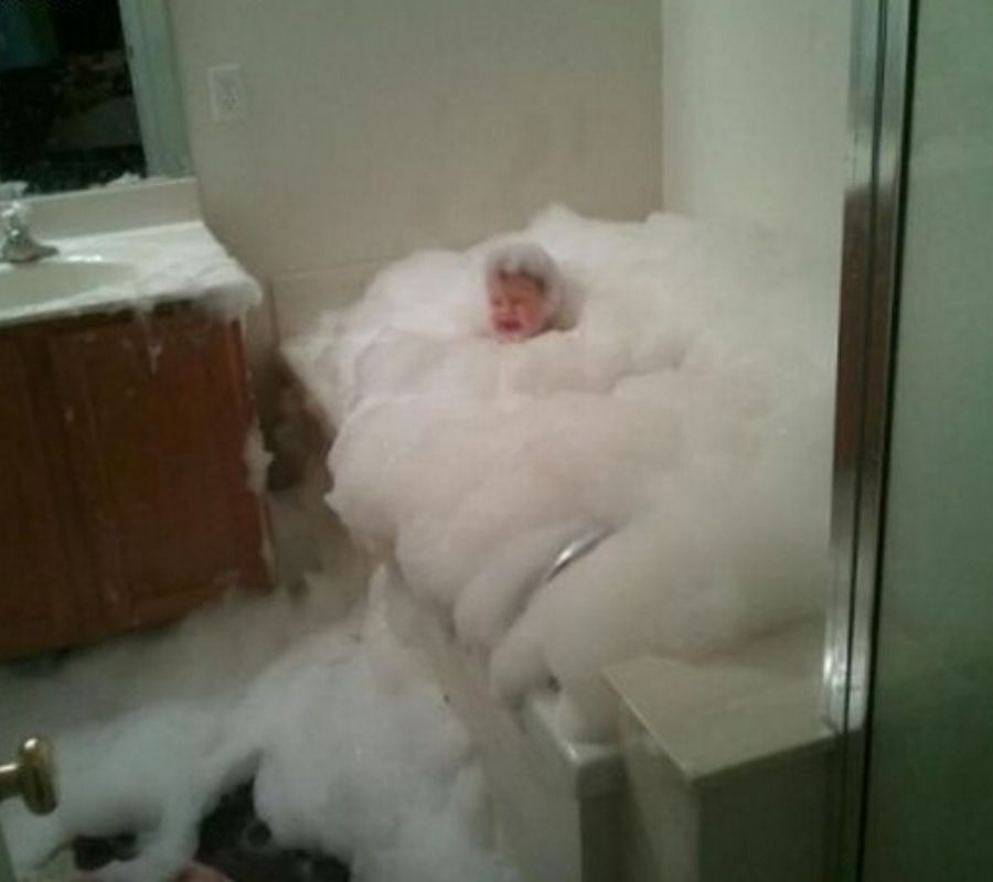 kid with too many bubbles in the bubble bath