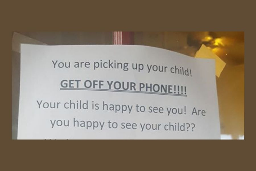 get off your phone sign at day care