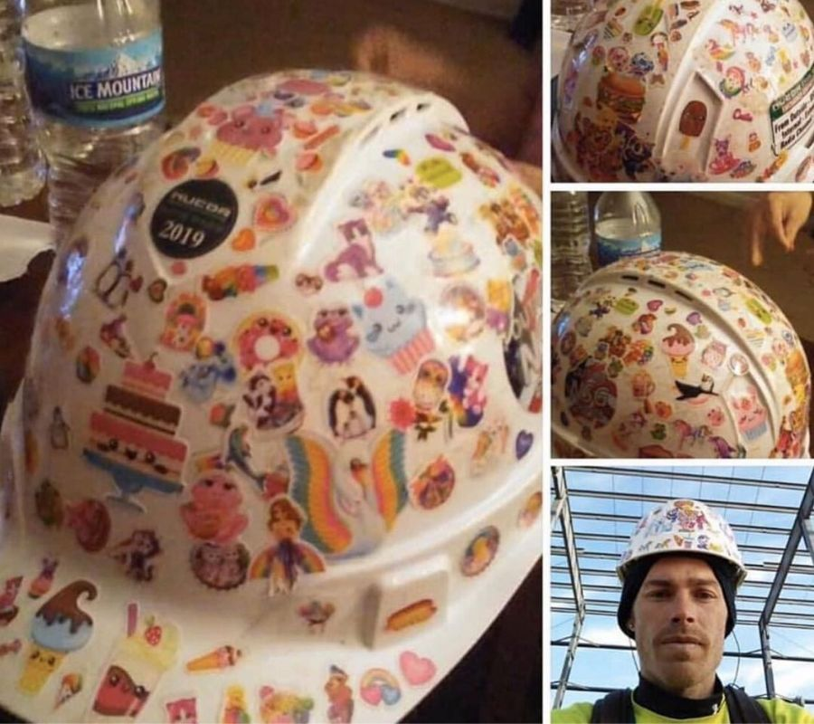 a man let his daughter put stickers all over his hard hat