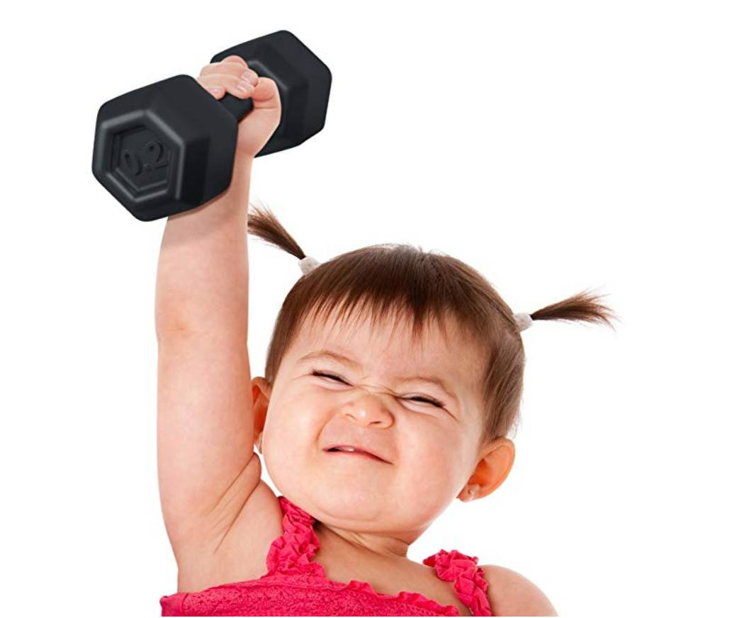 baby holding dumbell