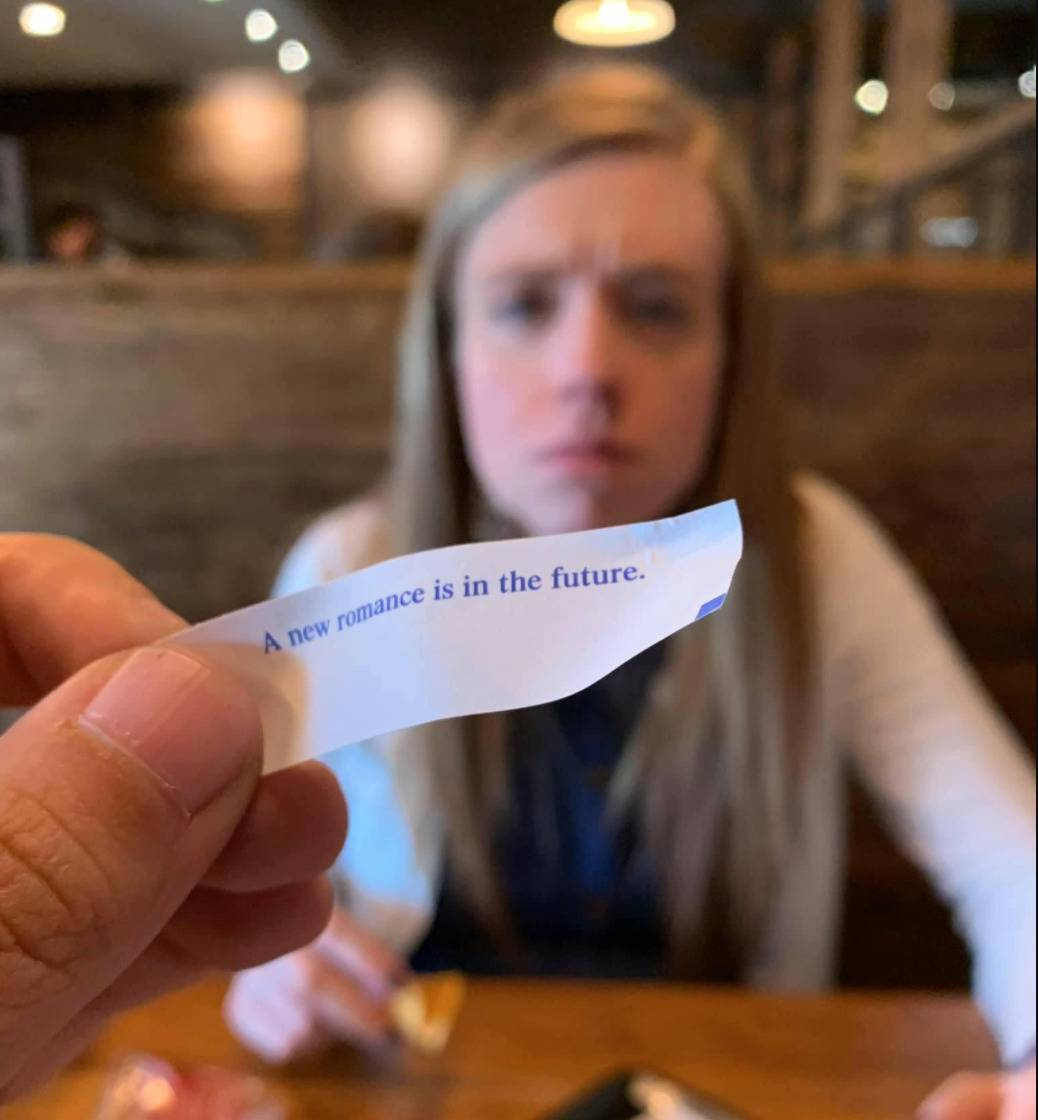 photo of man's fortune cookie that says