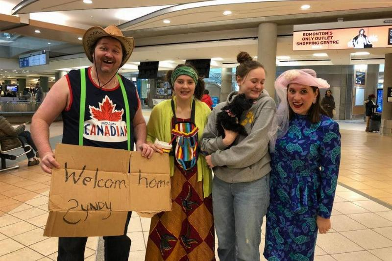 family picking someone up from the airport in redneck costumes