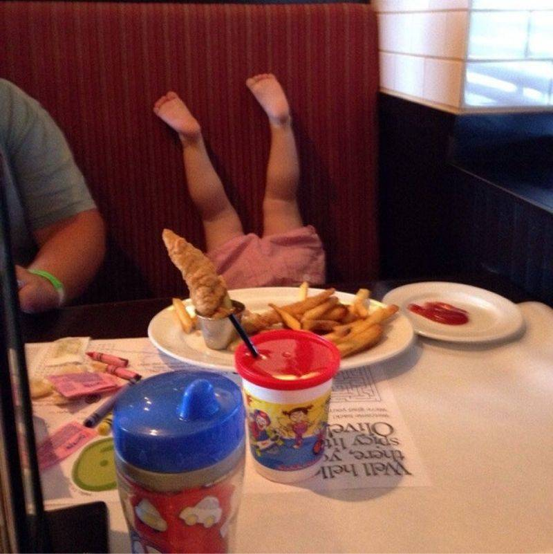 kid with feet up at table