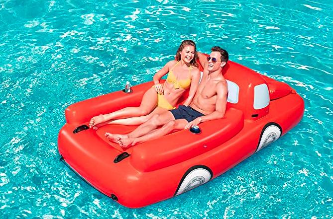 couple on truck-shaped pool floatie