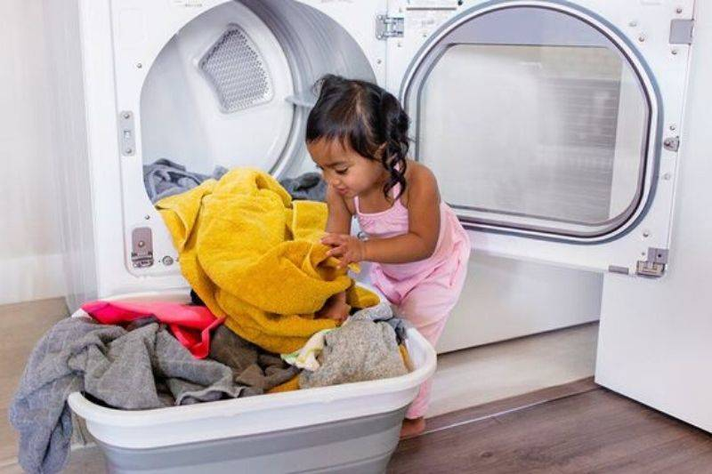 children helping to sort laundry