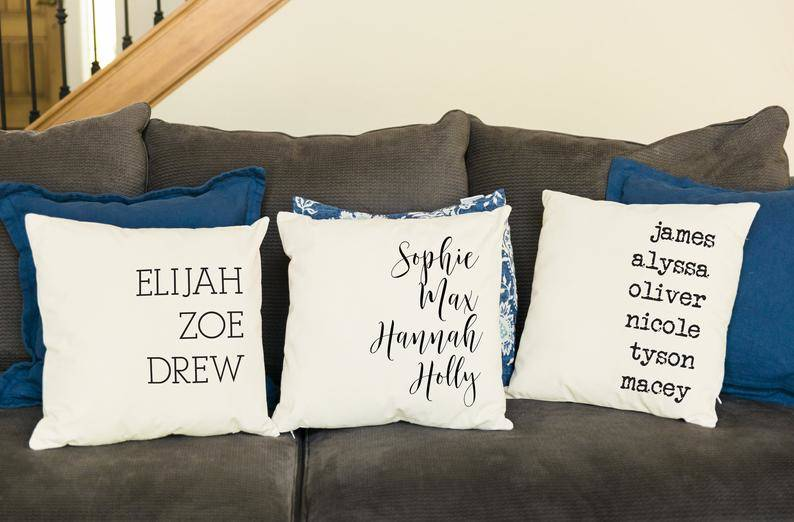 three pillows with the family's names on it
