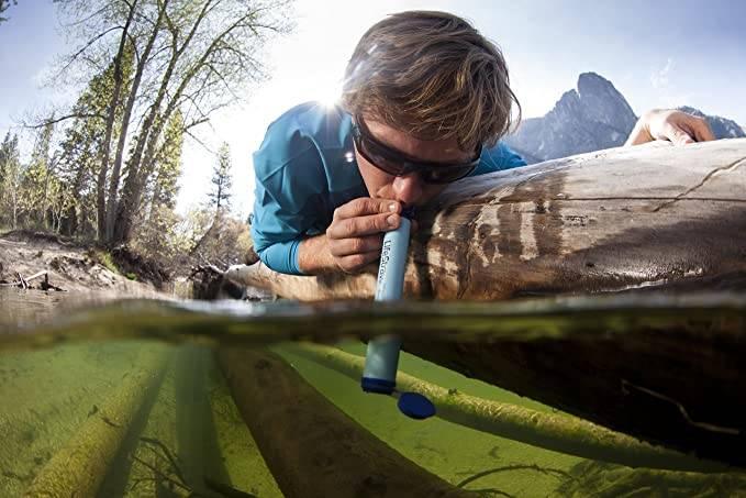 drinking stream water using lifestraw