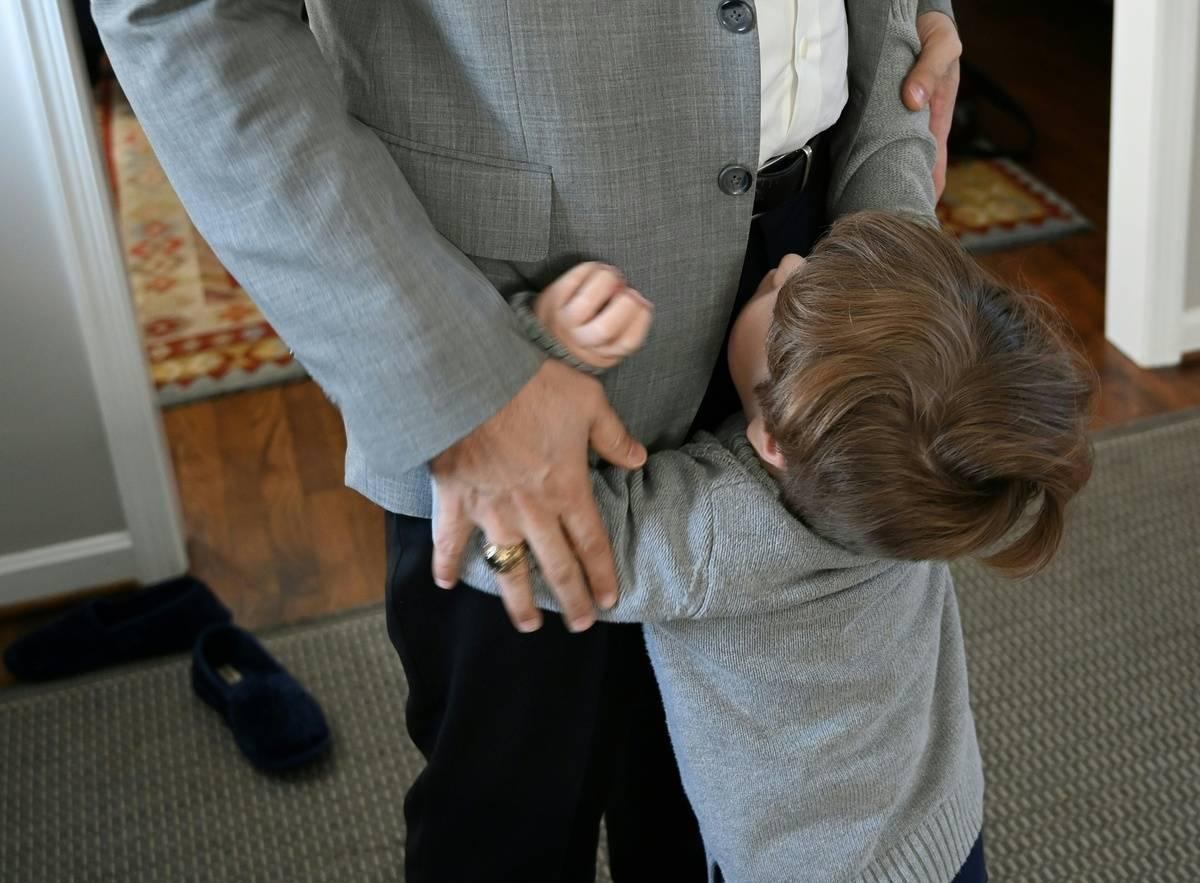 boy pleading with dad