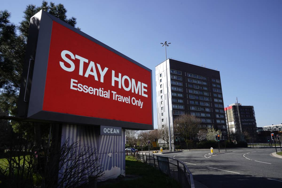 A giant television over the A57 Motorway urges people to stay home