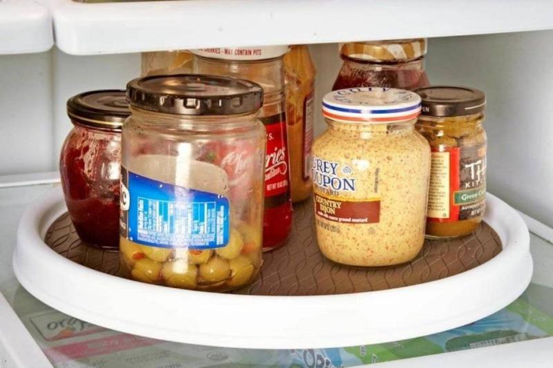 jars on a lazy susan in a fridge