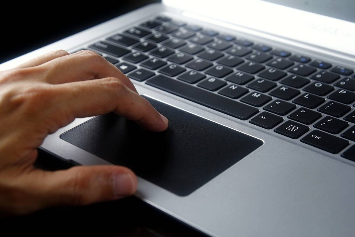 Person using gray laptop computer