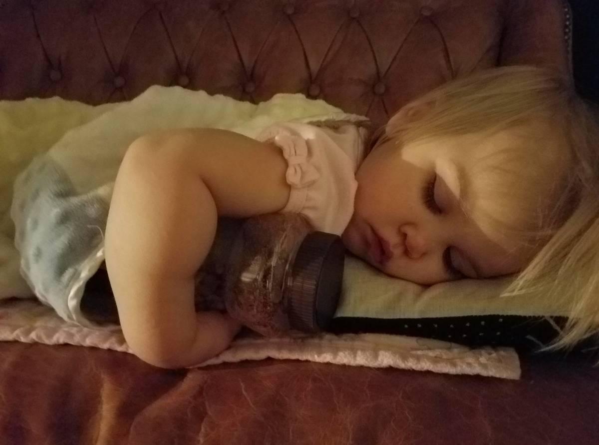 kid cuddling a jar of peanuts