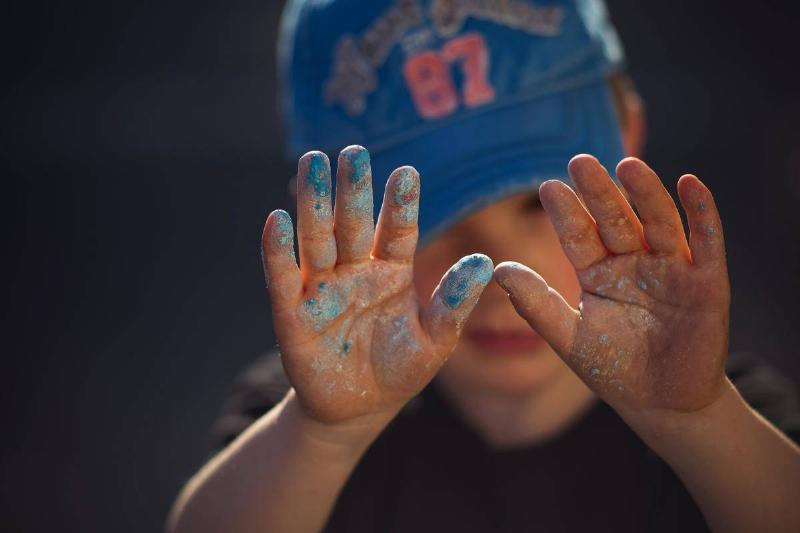 boy with paint all over hands
