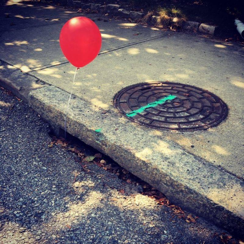 kid put a red balloon near a sewer like IT