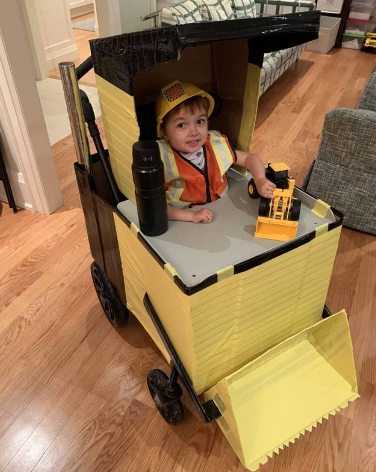 boy's wheelchair dressed up like construction digging machine