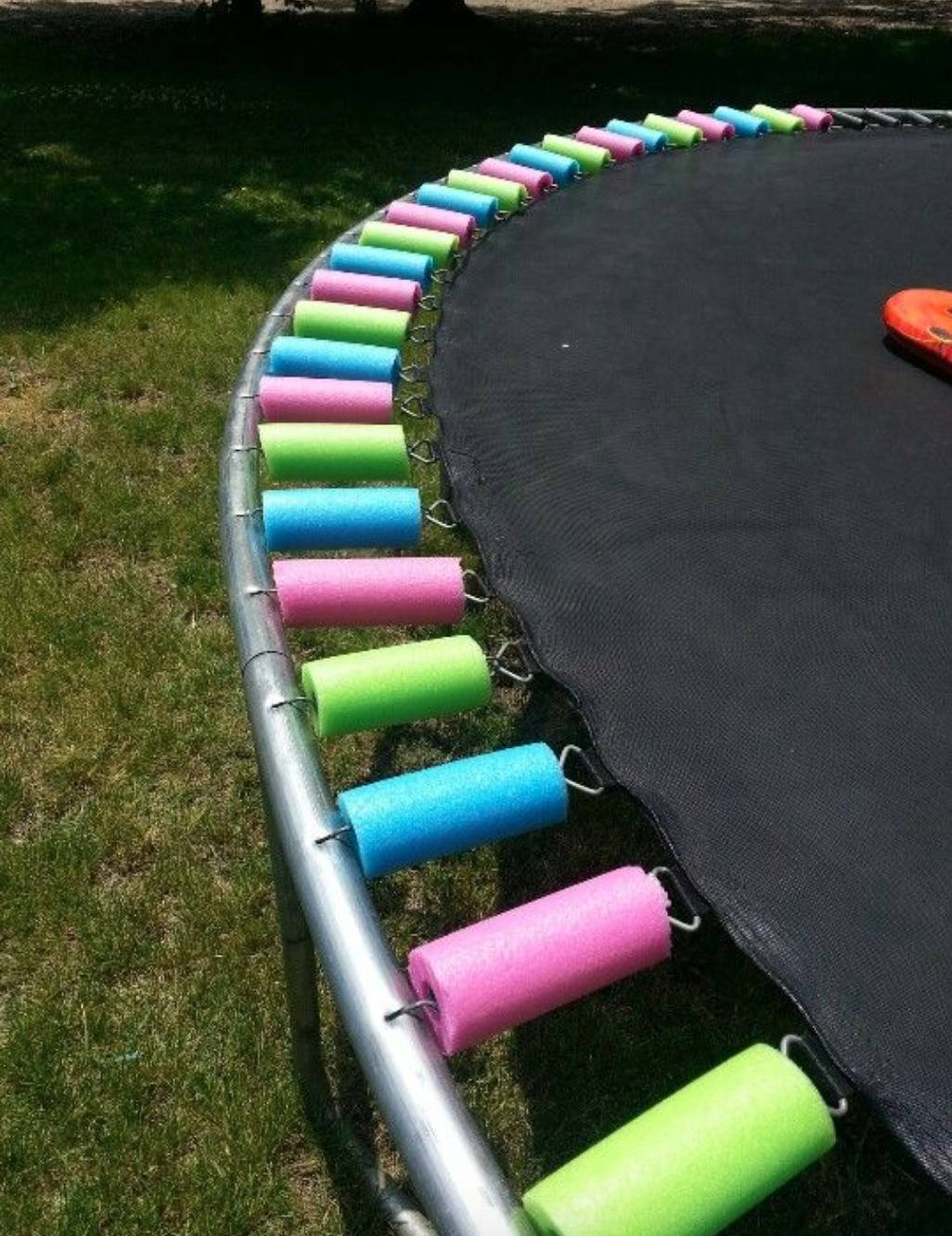 trampoline with springs covered in segments of foam pool noodles