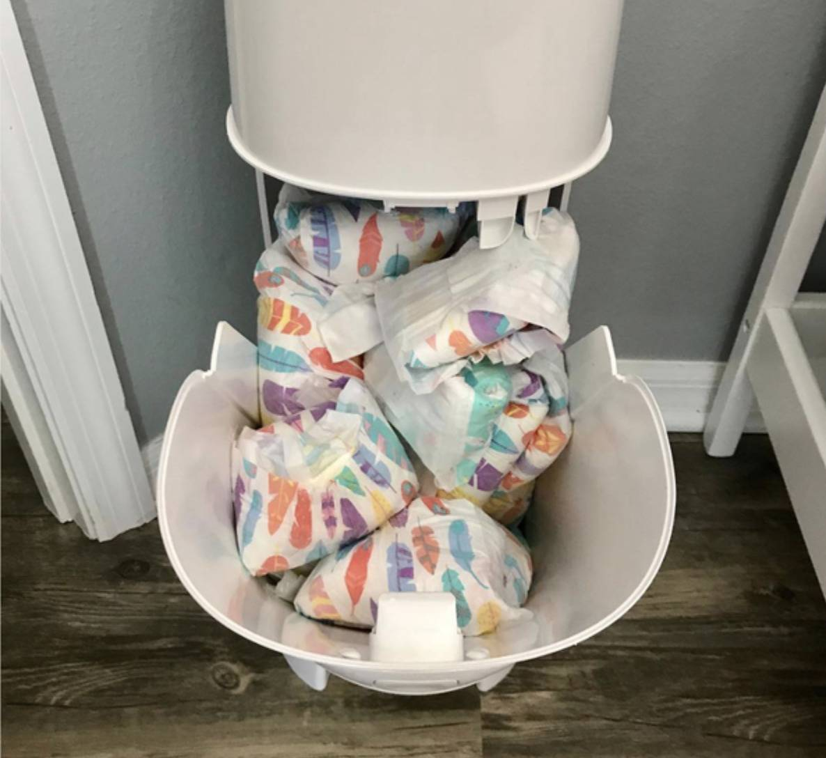 diapers spilling out of bin