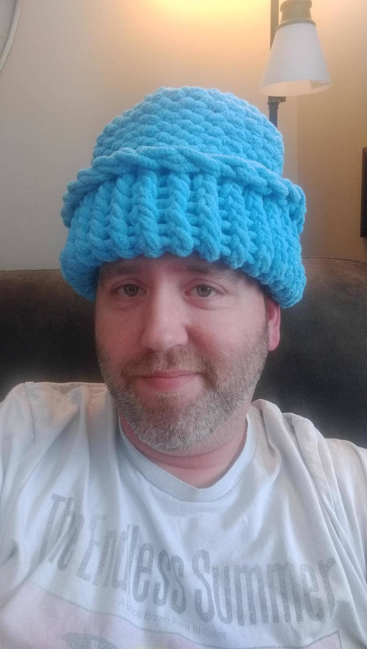 man wearing bright blue knitted hat