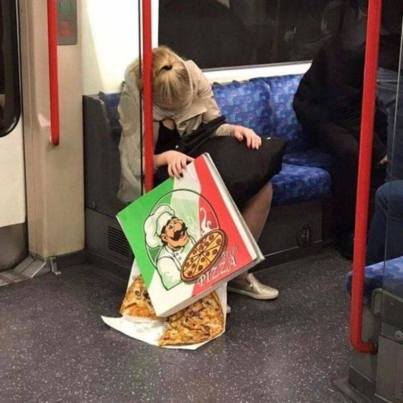 woman passed out on subway dropping pizza
