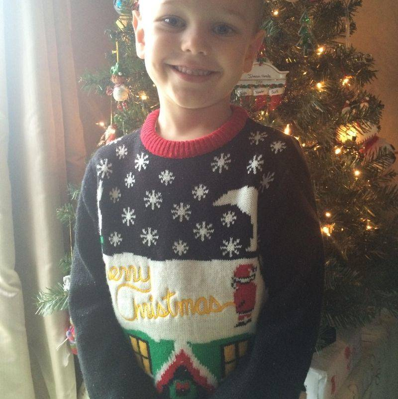 mom accidentally bought son a sweater with Santa peeing on it