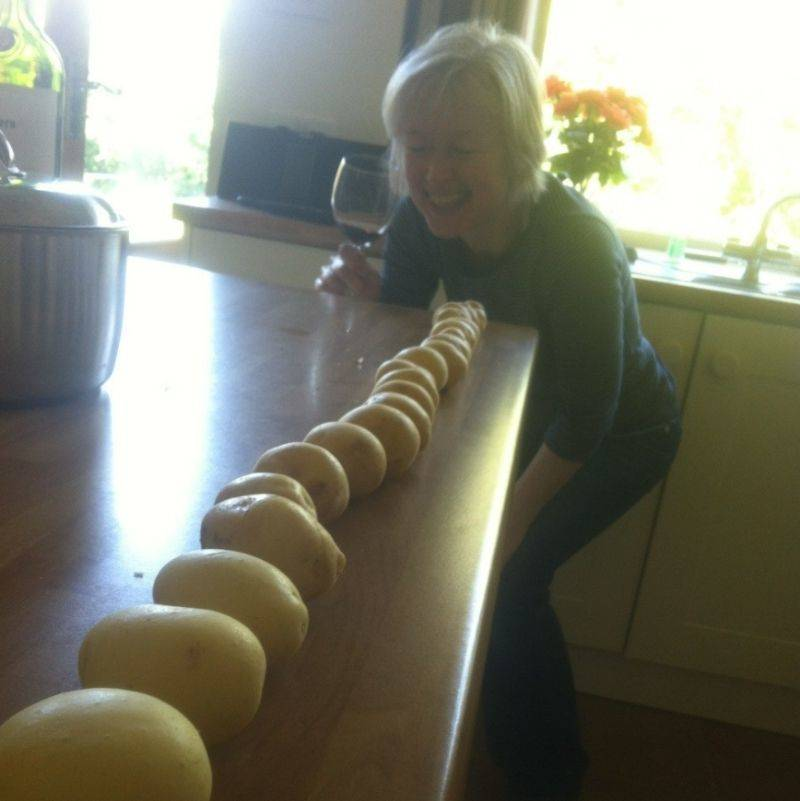 a mom drunk and laughing at potatoes arranged by size