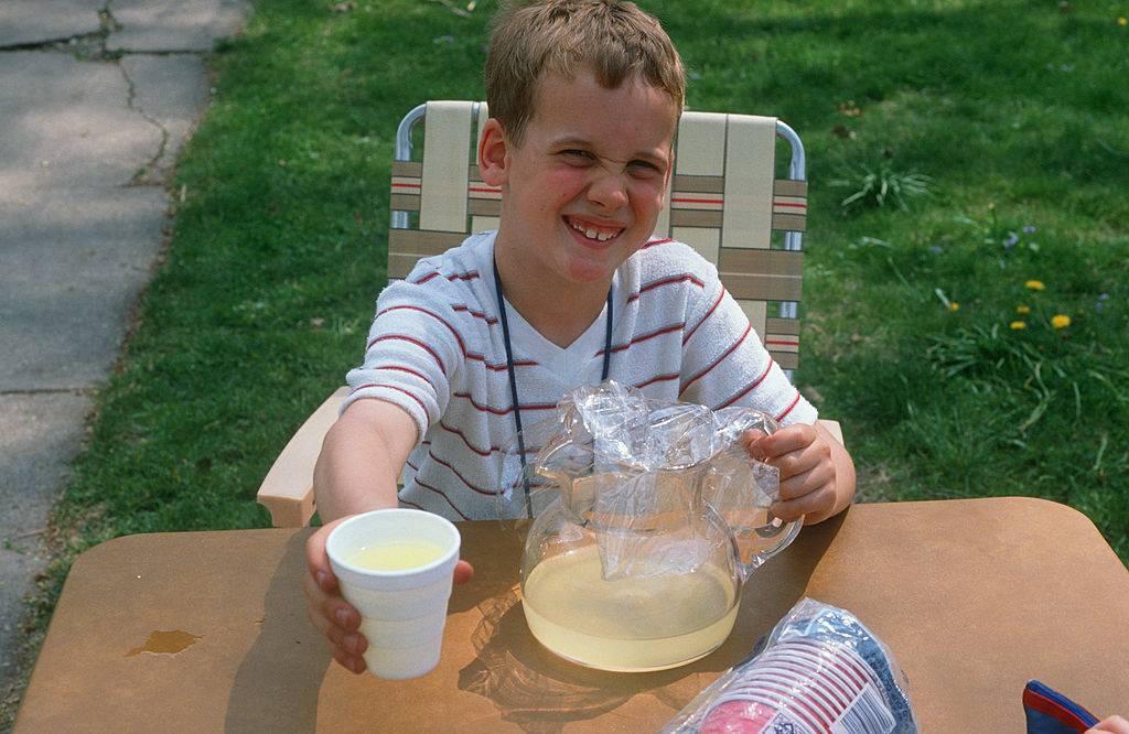 Boy selling lemonade, Chicago, Illinois
