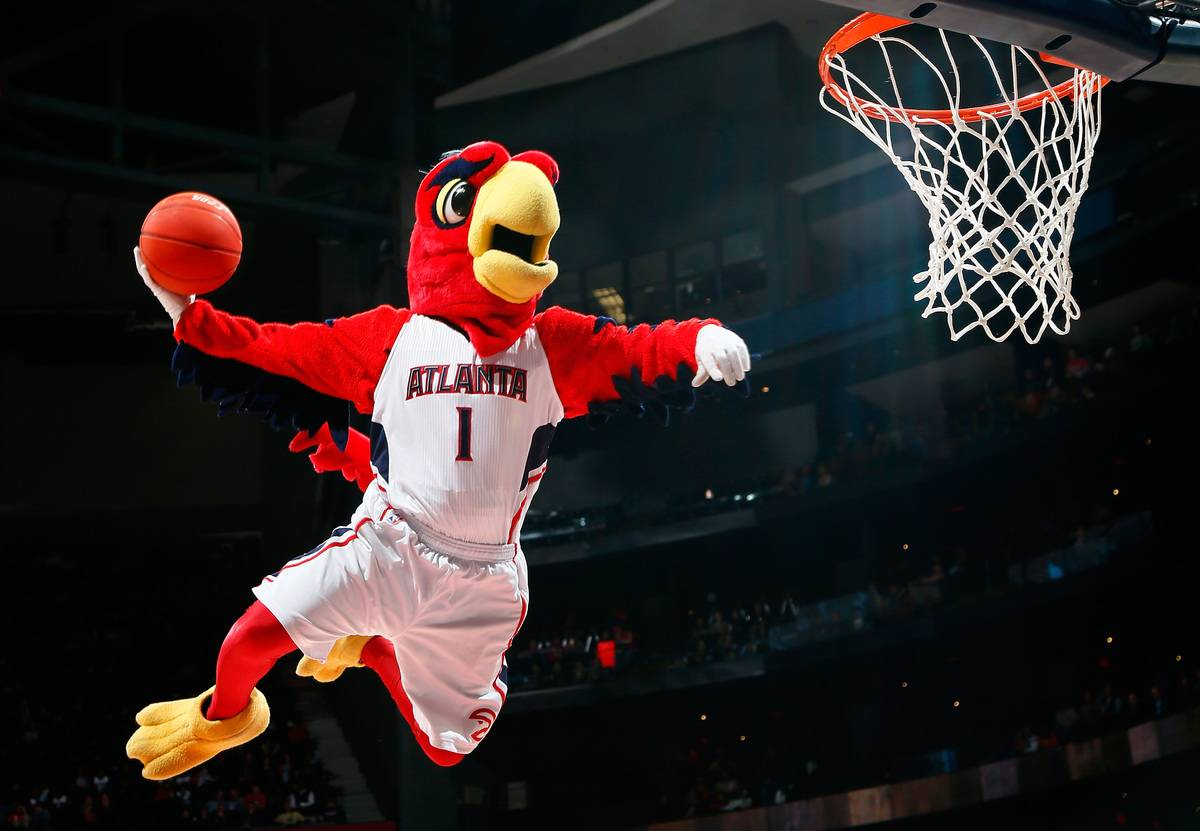 Harry the Hawk, mascot of the Atlanta Hawks, dunks during a timeout in the game