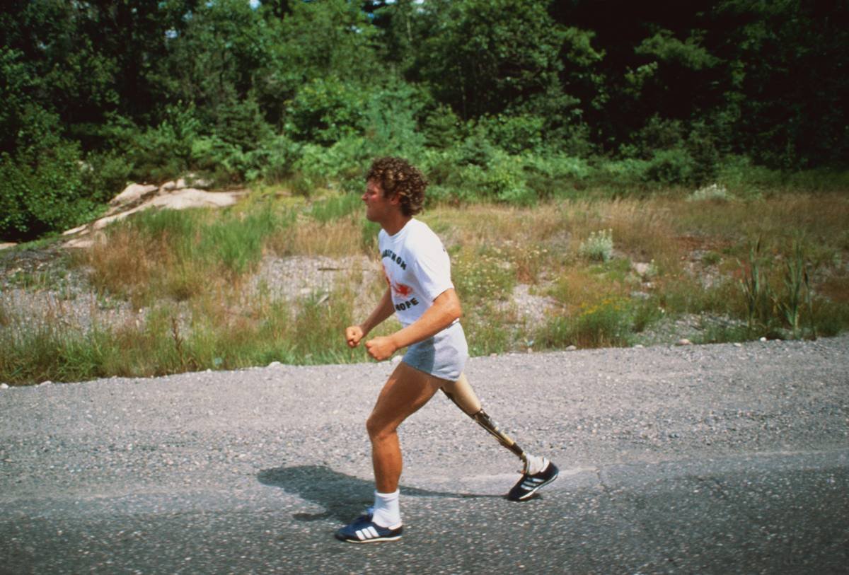 Terry Fox, age 22, is running coast-to-coast across Canada on an artificial limb, after losing his right leg to cancer three years ago, in an effort to raise money to fight the killer disease.