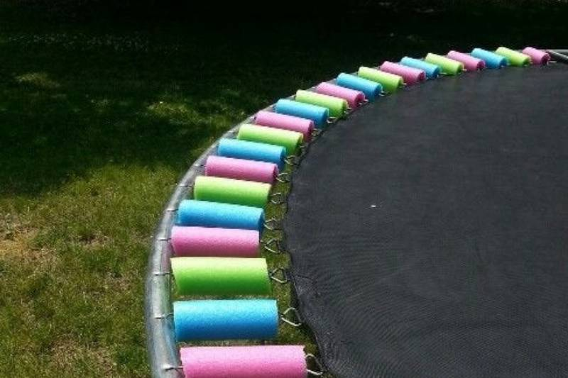 Cut up pools noodles on trampoline wires