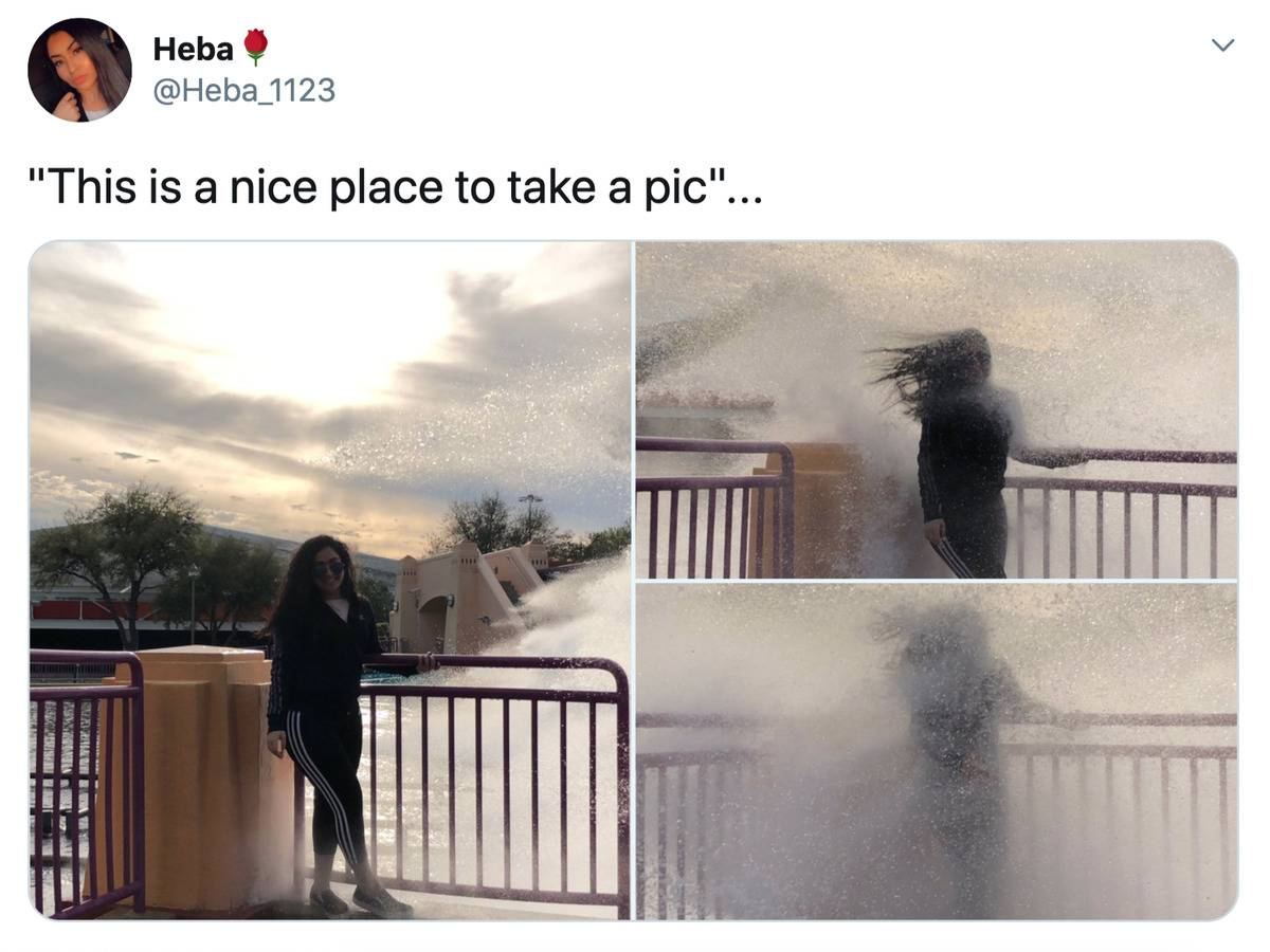 wave hitting woman while her picture is being taken