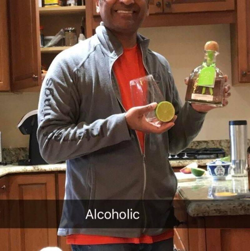 kid snapped a picture of their dad with tequila and put the caption