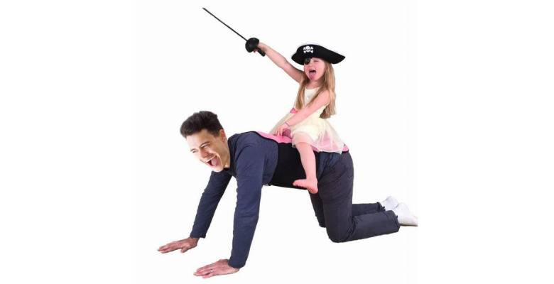 Child in pirate costume riding saddled father